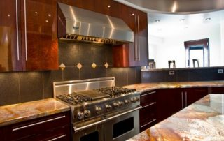 dark kitchen with granite tops