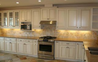 white kitchen with granite tops and backsplash