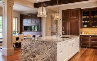 brown kitchen with granite island