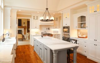 white kitchen with granite island