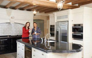 white kitchen with dark granite island