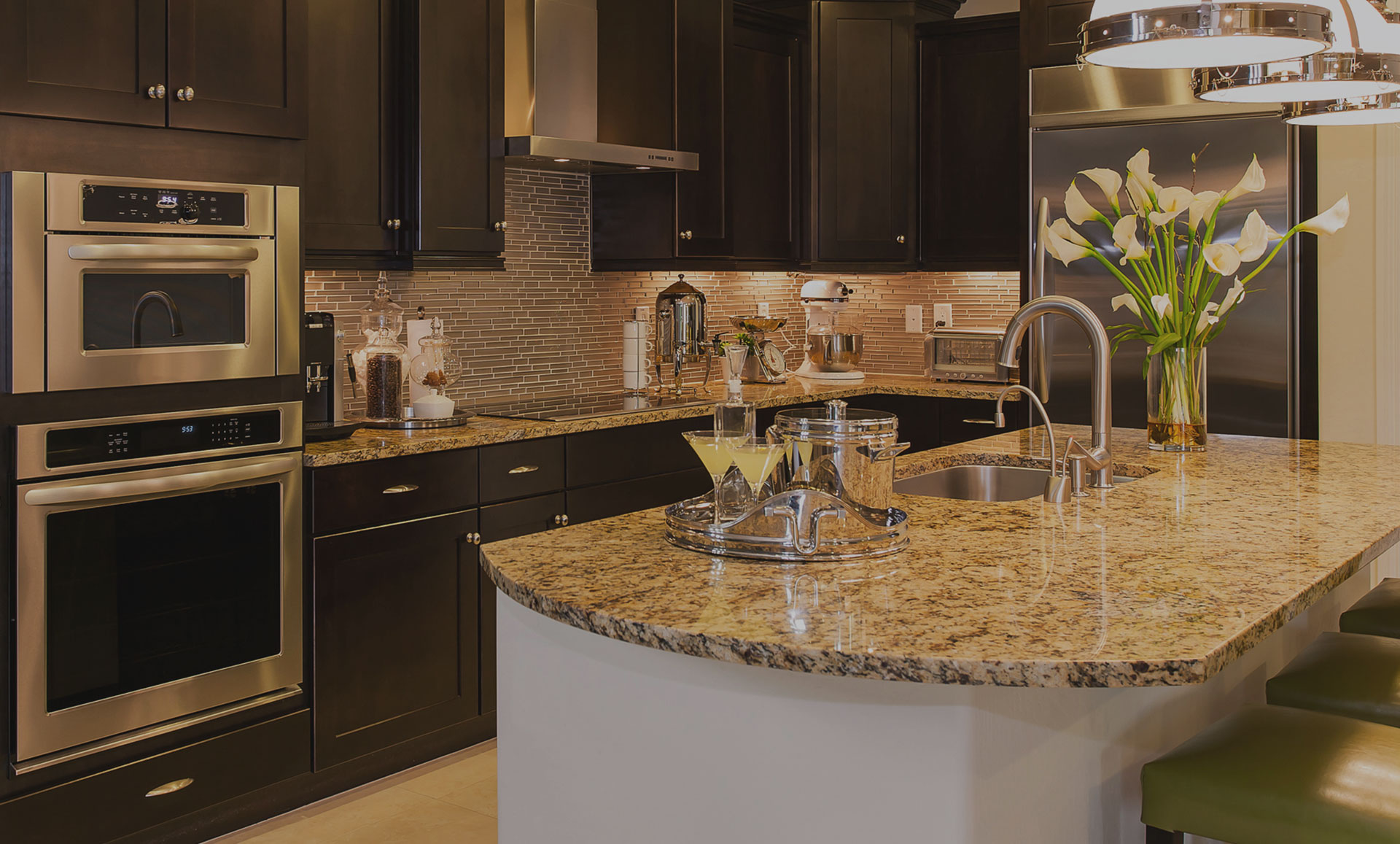 dark kitchen with granite island